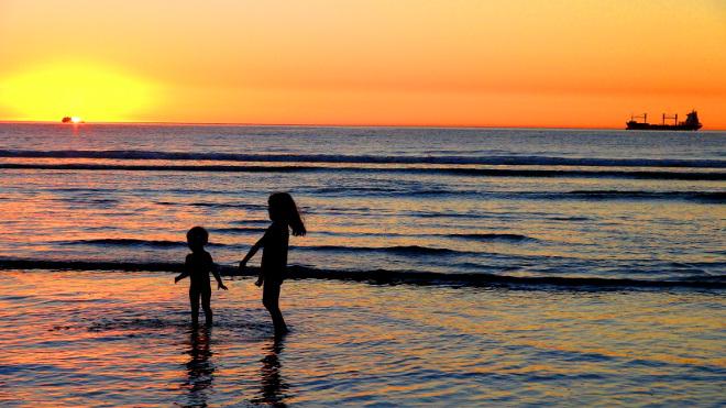 children playing on lagoon beach