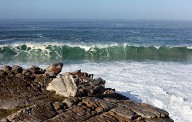 wave breaking on the beach next to The Windsor Hotel in Hermanus