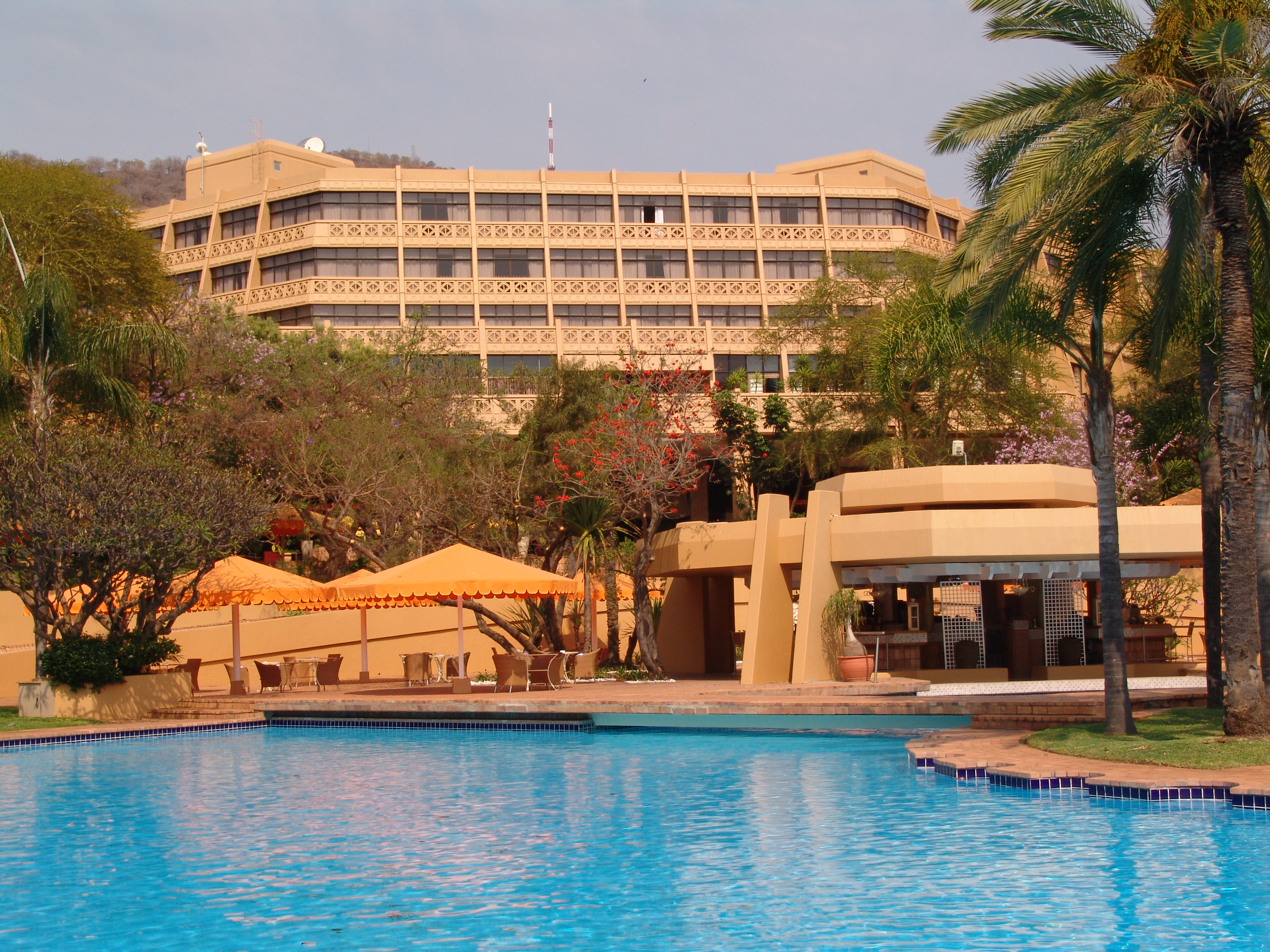 Sun City Hotel With The Pool In Foreground