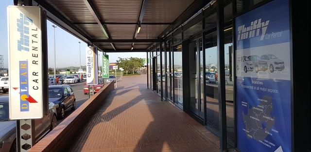 Dollar Thrifty car rental sign & offices at Durban's King Shaka International Airport