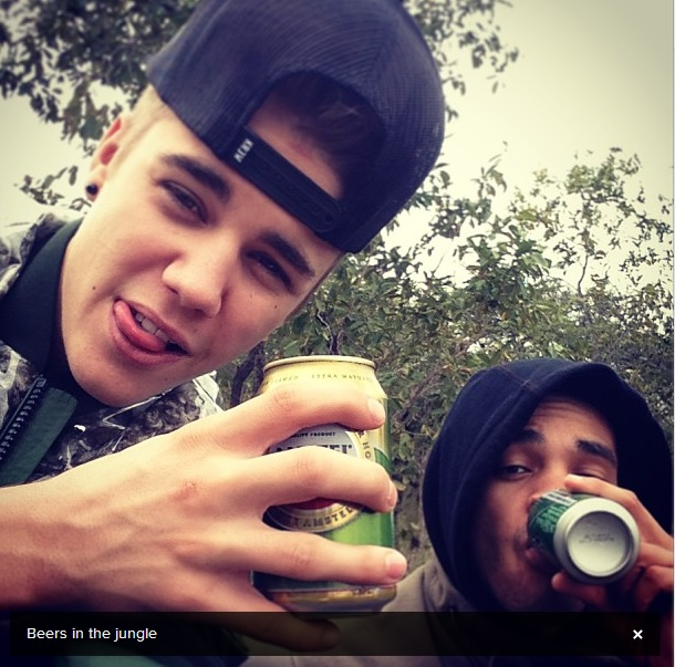 Justin Bieber drinking a beer