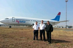 FlySafair pilots standing in front of a FlySafair aircraft