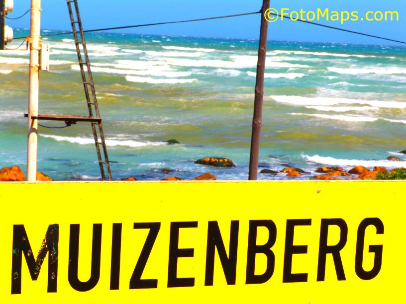 Muizenberg beach with the railway station sign