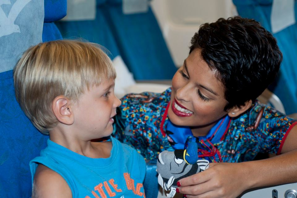 Air Seychelles cabin crew member looking after a child