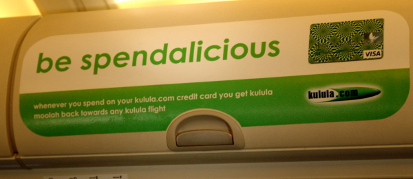 Kululal credit card advert on the overhead lockers