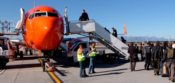 boarding a Mango Airlines plane in Cape Town