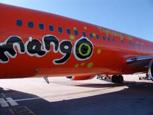 Mango logo on side of plane