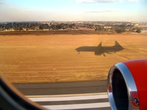 shadow of a Mango plane as it lands in Johannesburg, South Africa