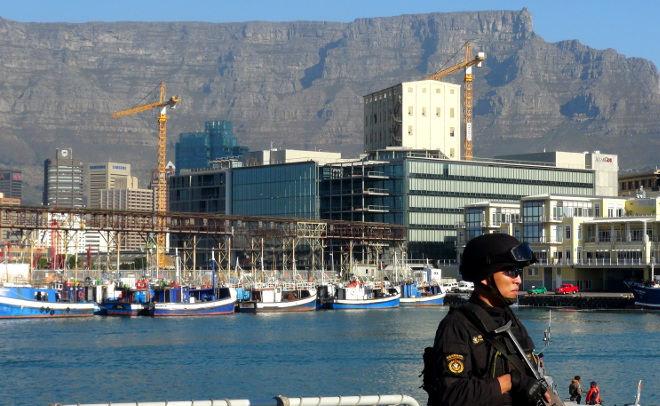 Sailor from the CNS Luoyang standing guard with Cape Town in the background