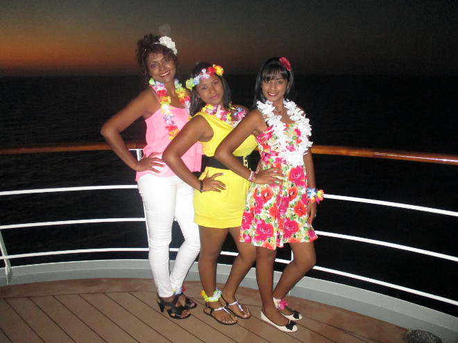Three passengers standing on the deck of the MSC Sinfonia
