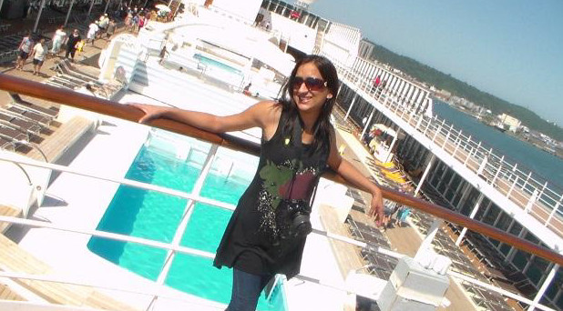 posing in front of the pool on the MSC Sinfonia cruise ship