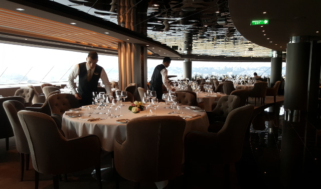 Waiters setting up tables in the MSC Yacht Club private restaurant, on the MSC Meraviglia