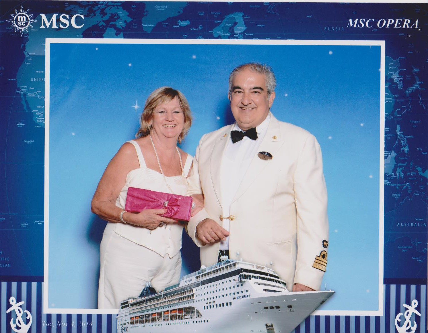 The captain of the MSC Opera standing next to a passenger