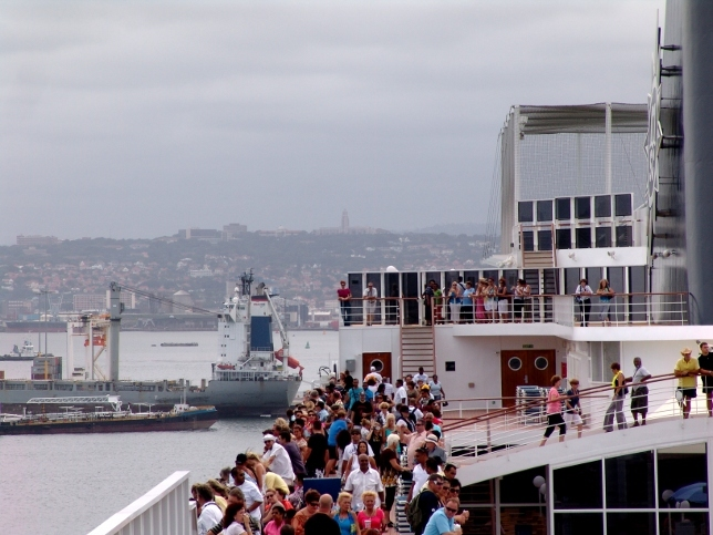 looking at the ships as the MSC Sinfonia cruises out of Durban harbour