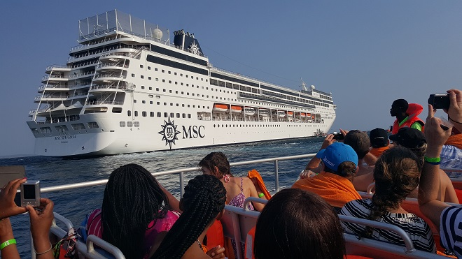 Taking photos of the MSC Sinfonia from a ferry boat