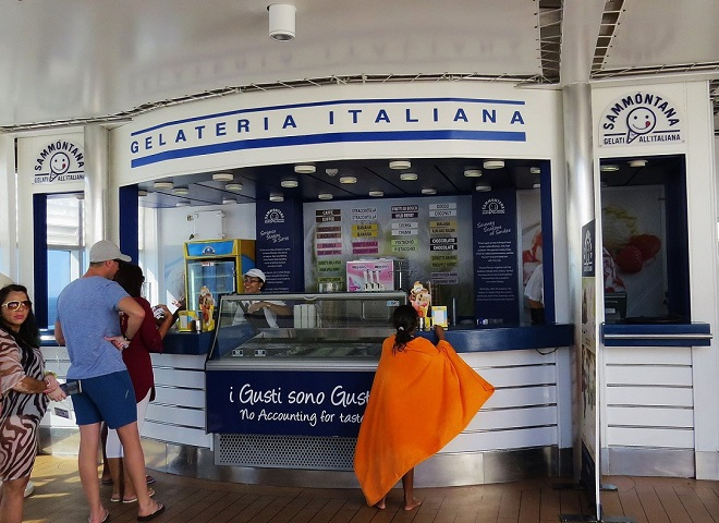 People waiting to be served at the Gelateria Italiana on the MSC Sinfonia's pool deck
